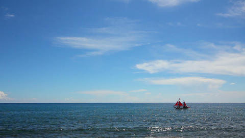 ship with red sails floating on sea Stock Video Footage