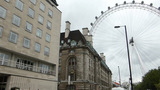 Pan from the street to part of London eye wheel, U Stock Video Footage