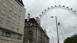 Pan from the street to part of London eye wheel, U Footage