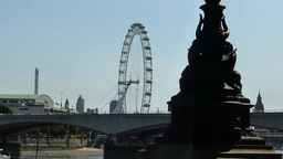 Distant zoom-out view of London Eye near river Thames,... Stock Video Footage