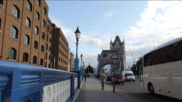 TRAFFIC & PEDESTRIANS CROSSING TOWER BRIDGE WITH S Stock Video Footage