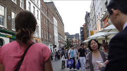 A crowded street in London Chinatown with sound (L Stock Video Footage