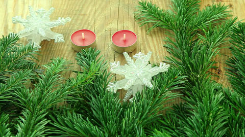 Christmas decoration with tree branch and candles Stock Video Footage