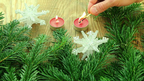 Christmas decoration with tree branch and candles Footage