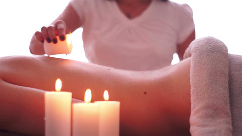 Hot Candle Wax Massage stock footage