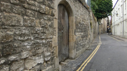 A stretch of stonewall in Oxford University town Stock Video Footage