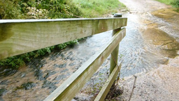 Spring Water Flows Over Road Path stock footage