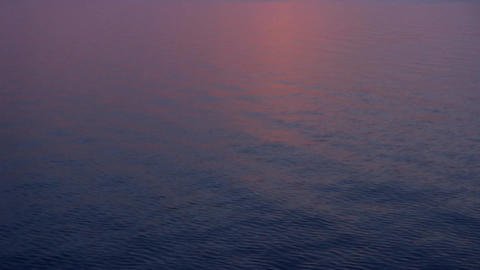 black sea purple sunset tilt Stock Video Footage