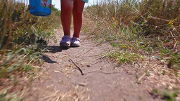 girl walking along the road Stock Video Footage