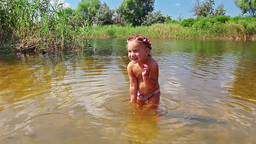 Little Girl Playing In The River stock footage