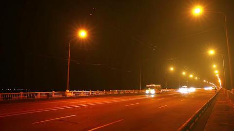 Timelapse of traffic on bridge at night. Blurred m Stock Video Footage
