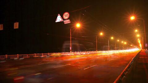 Timelapse of traffic on bridge at night Stock Video Footage