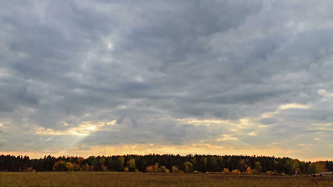 Rays of sun on a background autumn landscape. Time Footage