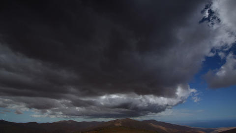 extreme dark storm clouds to sun time lapse 11199 Stock Video Footage
