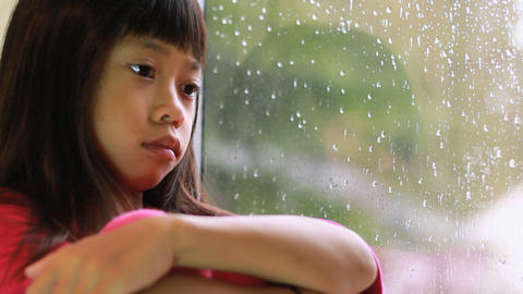 Little Asian Girl Depressed On A Rainy Day Footage