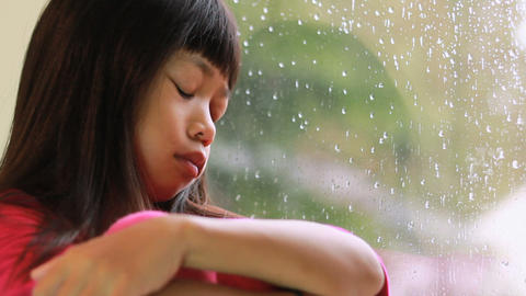 Little Asian Girl Depressed On A Rainy Day Stock Video Footage
