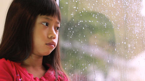 Sad Little Girl On A Rainy Day Footage