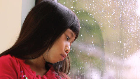Sad Little Girl On A Rainy Day Stock Video Footage