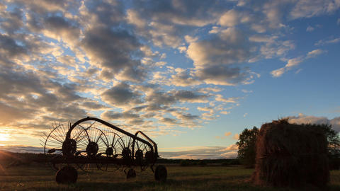 Tractor rake at sunset. Time Lapse Stock Video Footage