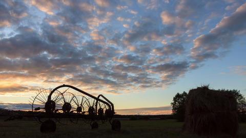 Tractor rake at sunset. Time Lapse Footage