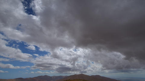 extreme dark storm clouds to sun time lapse 11222 Stock Video Footage