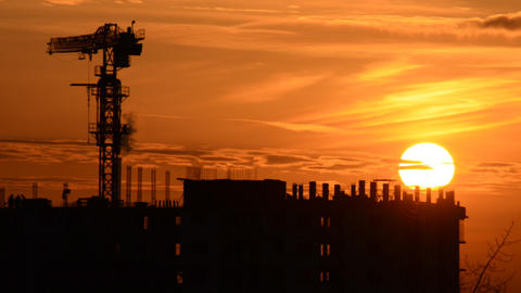 Time Lapse Sunset with Silhouettes of Crane and Wo Stock Video Footage