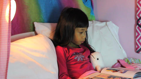 Little Asian Girl Reading Night Time Story Stock Video Footage
