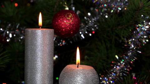 candle lit in front of festive lights Christmas tr Stock Video Footage