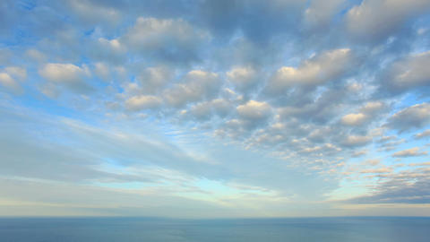 Cloudy sky over the sea (Time Lapse). FULL HD Live Action