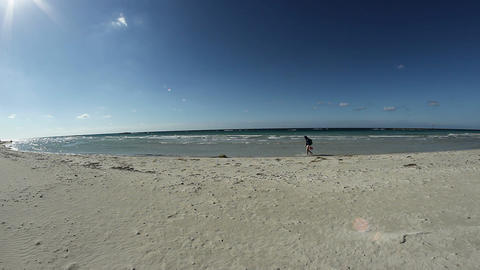 a man walking along the shore Stock Video Footage