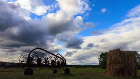 Tractor rake on a background of clouds. Time Lapse Stock Video Footage