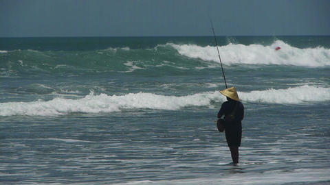 Fishing from the beach, Bali, Indonesia Stock Video Footage