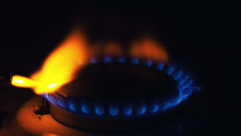 Igniting the gas stove with lighter Stock Video Footage