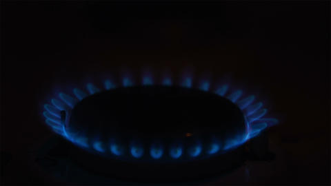 Igniting the gas stove with match Stock Video Footage