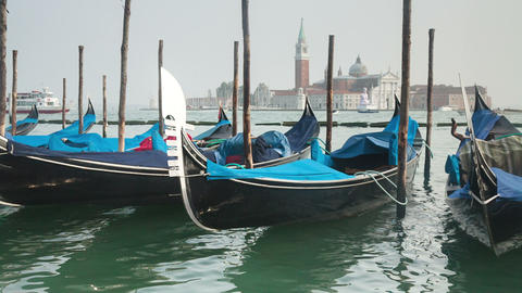 Venetian Gondolas Tied Near The Pier On San Marco  stock footage
