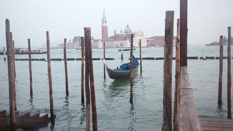 Venetian gondolas tied near the pier on San Marco Stock Video Footage