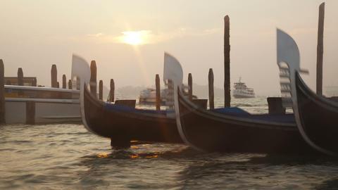 Venetian gondolas tied near the pier on San Marco Stock Video Footage