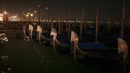 Venetian gondolas tied near the pier at night on S Stock Video Footage