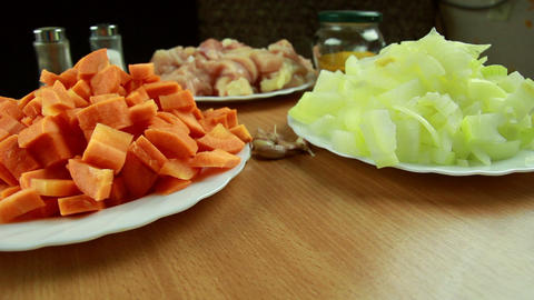 Carrot, onion, garlic and meat - ingredients for r Stock Video Footage
