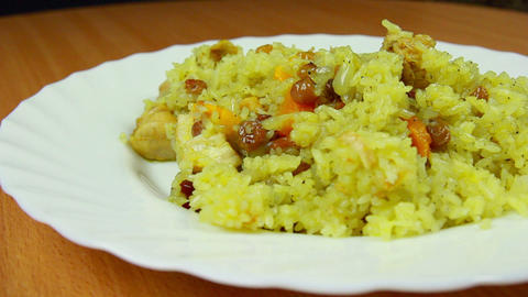 Fresh and hot pilaf in plate, dolly shot Stock Video Footage