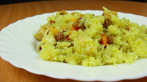 Fresh and hot pilaf in plate, dolly shot Footage