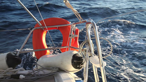 Lifebuoy on the yacht racing in the sea Stock Video Footage