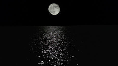 Moonlight Path With Low Fool Moon Above The Sea stock footage