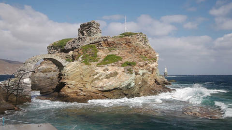 Rock and lighthouse at the stormy sea on greek isl Stock Video Footage