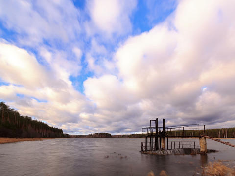 Dam on the background of clouds. Time Lapse. 4x3 Footage