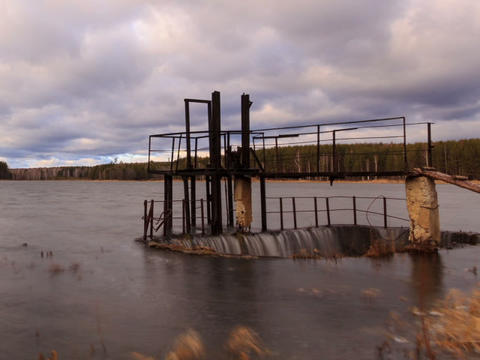 Dam on the background of clouds. Time Lapse Stock Video Footage