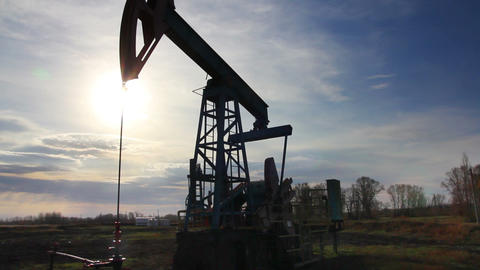 working oil pump at sunset Stock Video Footage