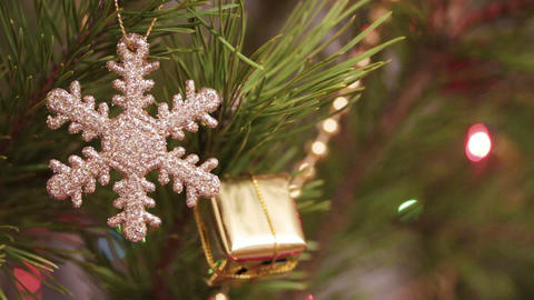 decorative snowflake on christmas tree decorated w Stock Video Footage