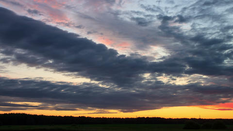 Cloud melts at sunset. Time Lapse. 4K Stock Video Footage
