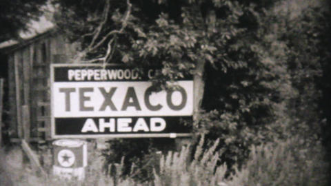 Car Getting Serviced At Texico Station 1940 Vintag stock footage